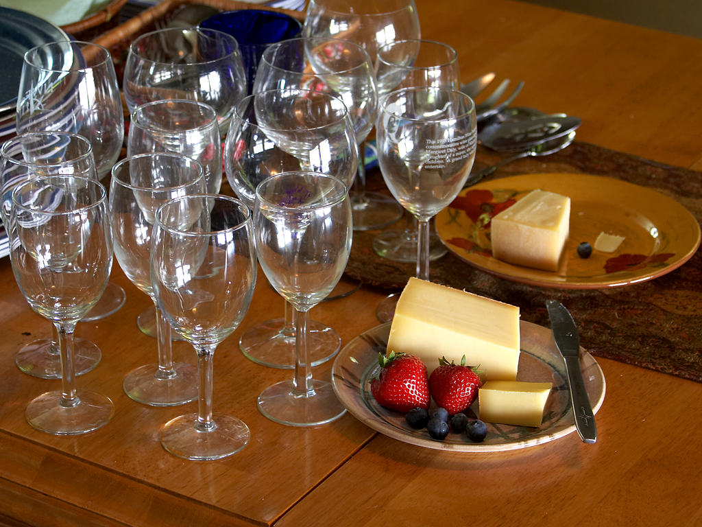 wine glasses stawberries and cheese still life studio photo