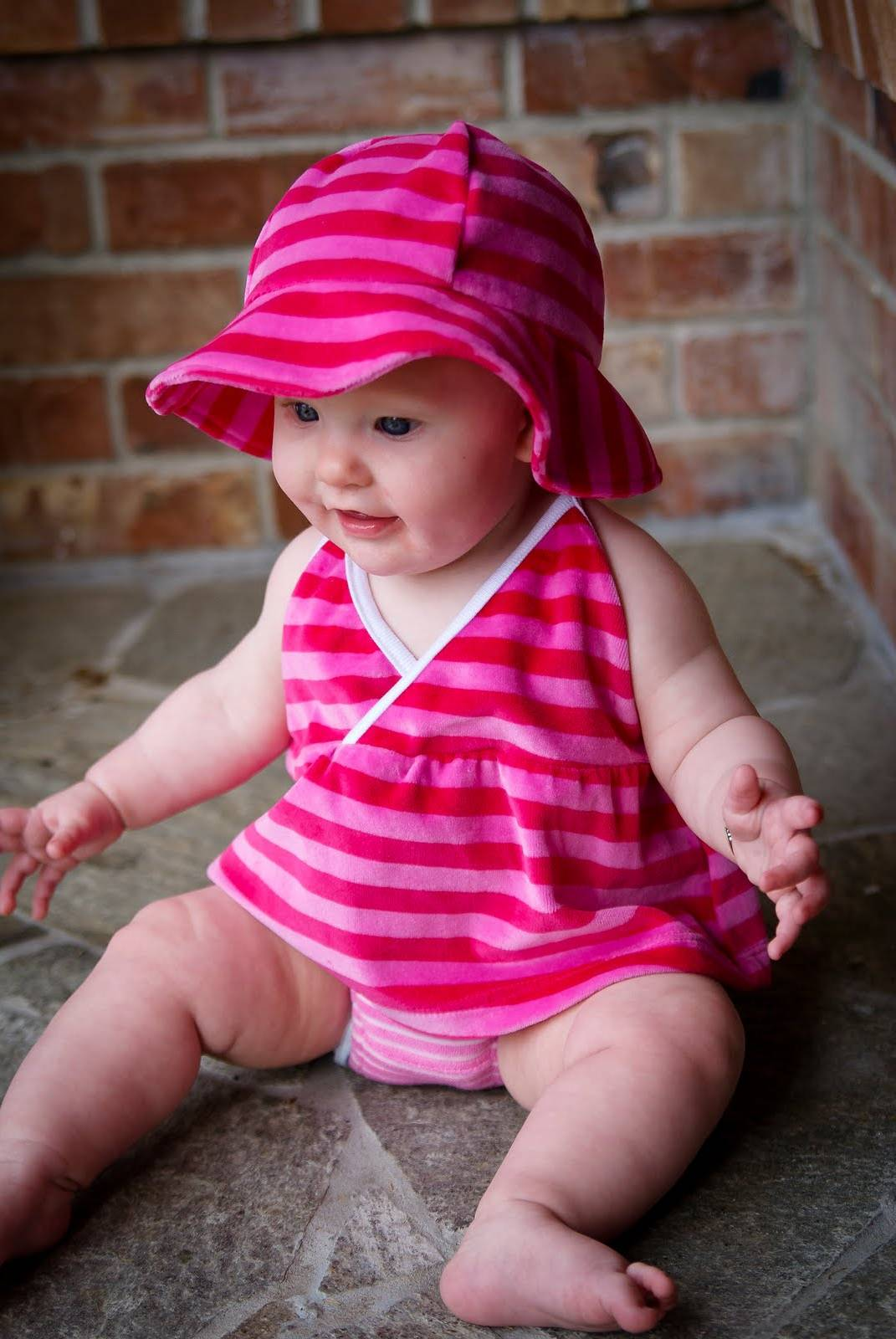 Cute Baby Girl Wearing Pink Dress And Blue Eyes Wallpaper