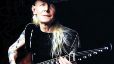 Johnny Winter playing a Gibson Firebird Wallpaper