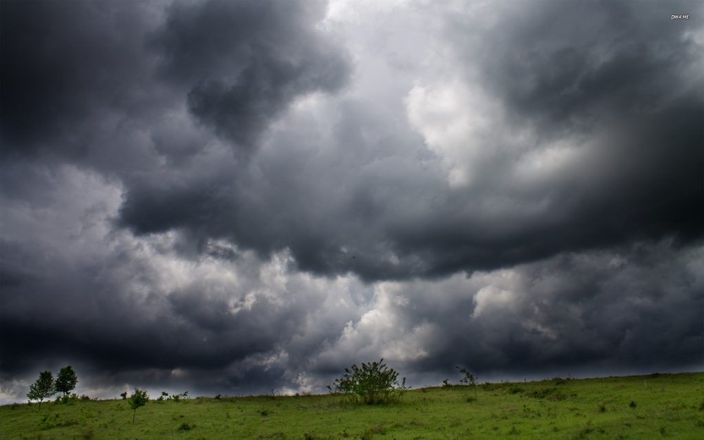 Storm clouds over the field wallpaper